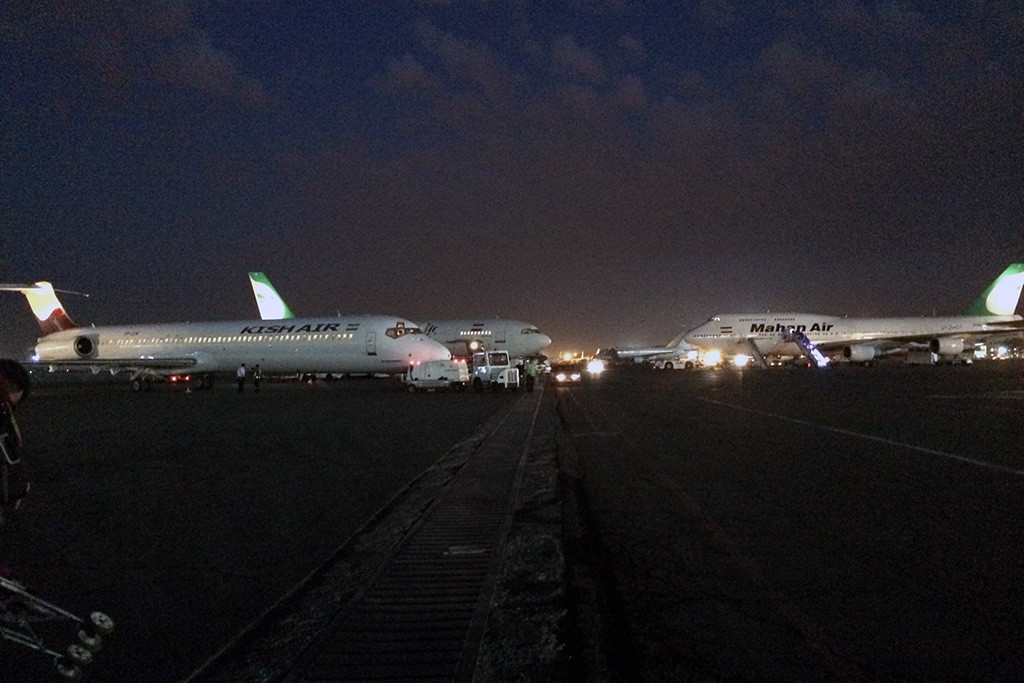 Early morning apron at Mehrabad airport with the infamous Mahan 747-300 getting ready for its flight.