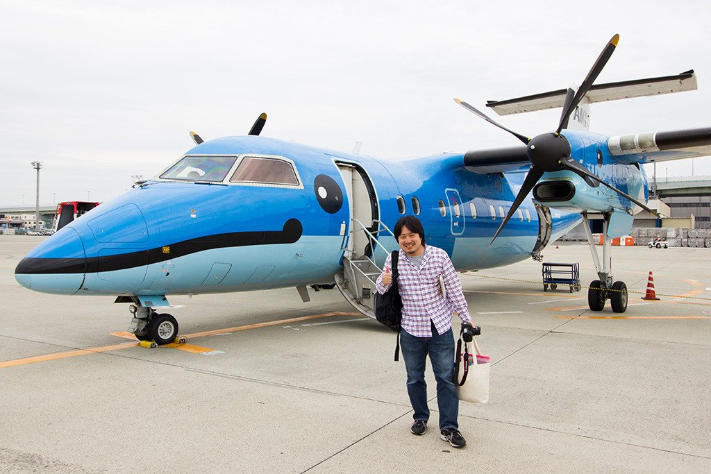 Yukihiro posing with our aircraft after arrival in Osaka.