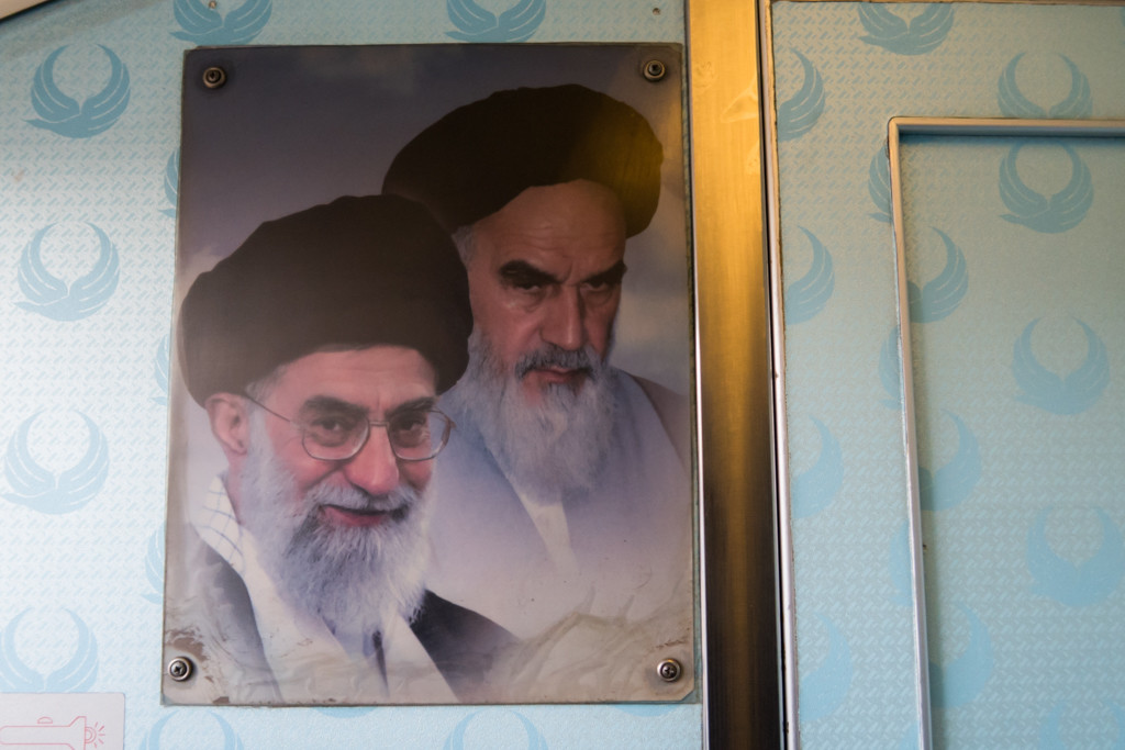 Portrait of Hassan Rouhani - the President and Ali Khamenei - the Supreme Leader next to the cockpit door.