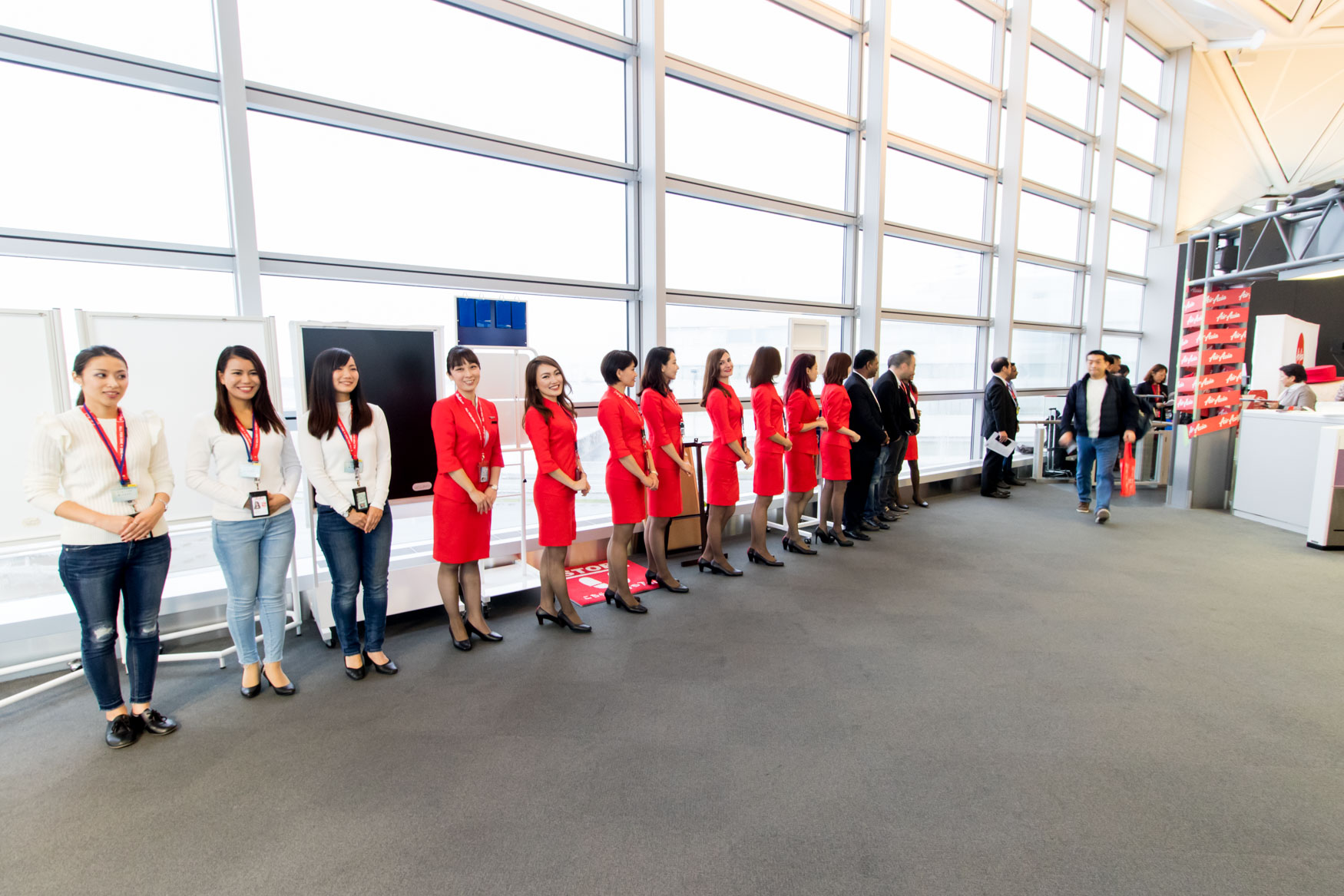 AirAsia Staff Welcoming Passengers on the Inaugural Flight